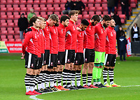 Lincoln City players observe the silence for Remembrance Day<br /> <br /> Photographer Andrew Vaughan/CameraSport<br /> <br /> The EFL Sky Bet League Two - Crewe Alexandra v Lincoln City - Saturday 11th November 2017 - Alexandra Stadium - Crewe<br /> <br /> World Copyright &copy; 2017 CameraSport. All rights reserved. 43 Linden Ave. Countesthorpe. Leicester. England. LE8 5PG - Tel: +44 (0) 116 277 4147 - admin@camerasport.com - www.camerasport.com