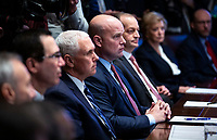 Matthew Whitaker, acting U.S. attorney general, listens beside U.S. Vice President Mike Pence as U.S. President Donald Trump speaks during a cabinet meeting in the Cabinet Room of the White House, on Wednesday, Jan. 2, 2019 in Washington, D.C. Photo Credit: Al Drago/CNP/AdMedia