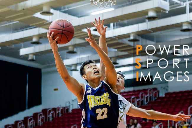 Fong Shing Yee #22 of Winling Basketball Club (L) tries to score next to Ling Kwan Lung #22 of Eagle Basketball Team (R) during the Hong Kong Basketball League game between Eagle and Winling at Southorn Stadium on May 4, 2018 in Hong Kong. Photo by Yu Chun Christopher Wong / Power Sport Images