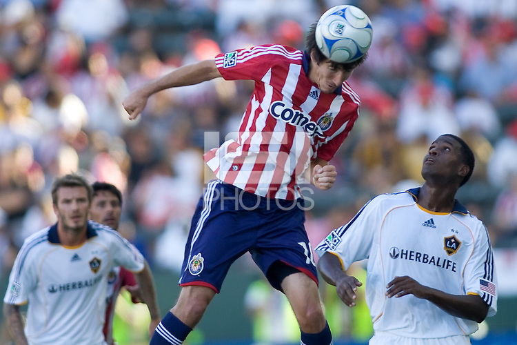 Chivas USA midfielder Sacha Kljestan heads a ball past LA Galaxy forward Edson Buddle. The LA Galaxy and Chivas USA played to 2-2 draw during a MLS Western Conference playoff game at Home Depot Center stadium in Carson, California on Sunday November 1, 2009...