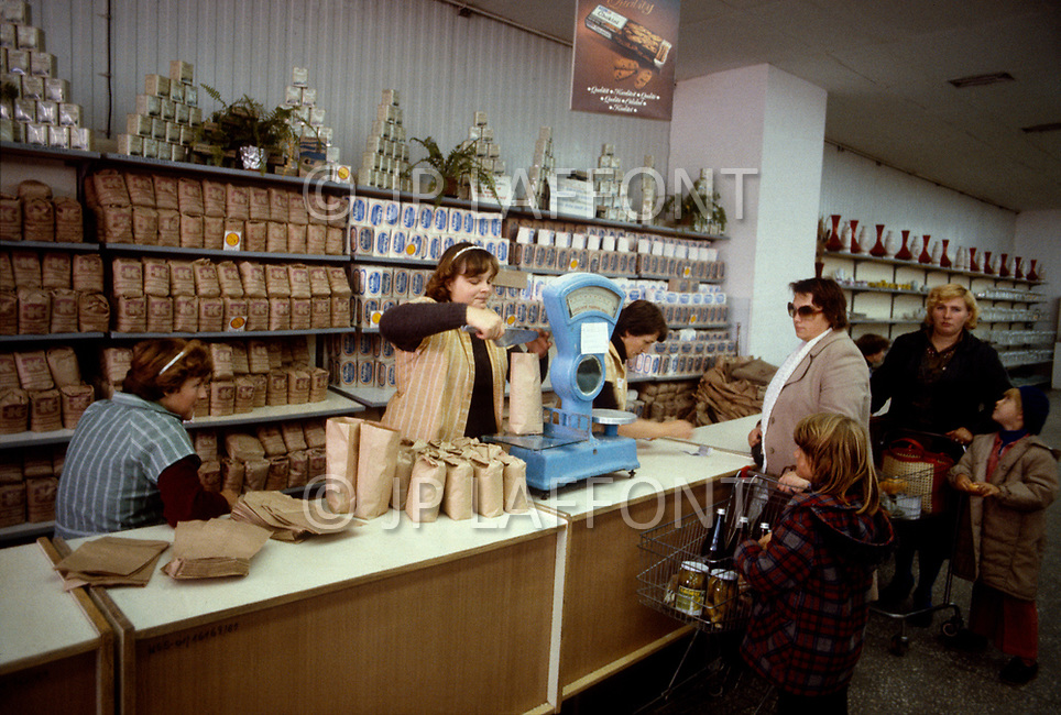 Poland, September, 1981 - People shopping at a state-run supermarket in the Warsaw suburbs. Because most of what is grown in Poland is distributed elsewhere in the USSR, shoppers endure long lines and shortages of nearly everything.