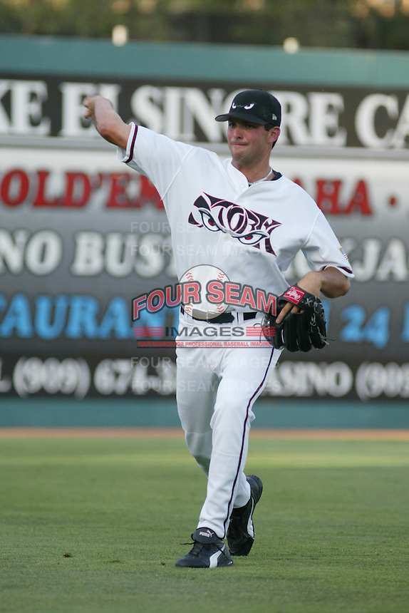 Justin Germano of the Lake Elsinore Storm warms up before pitching during a game at The Diamond on July 8, 2003 in Lake Elsinore, California. (Larry Goren/Four Seam Images)