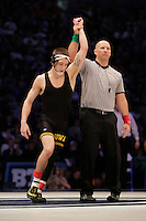 STATE COLLEGE, PA - FEBRUARY 8: Josh Dziewa of the Iowa Hawkeyes gets his hand raised after defeating Kade Moss of the Penn State Nittany Lions after their match on February 8, 2015 at the Bryce Jordan Center on the campus of Penn State University in State College, Pennsylvania. The Hawkeyes won 18-12. (Photo by Hunter Martin/Getty Images) *** Local Caption *** Josh Dziewa