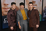 a _ Jonas, Joe Jonas, and Kevin Jonas 003 arrives at the Premiere Of Amazon Prime Video's Chasing Happiness at Regency Bruin Theatre on June 03, 2019 in Los Angeles, California.