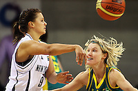 Tall Ferns guard Susie Bates passes under pressure from Jessica Bibby during the International women's basketball match between NZ Tall Ferns and Australian Opals at Te Rauparaha Stadium, Porirua, Wellington, New Zealand on Monday 31 August 2009. Photo: Dave Lintott / lintottphoto.co.nz
