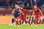 Haraguchi Genki of Japan (L) fights for the ball with Nguyen Huy Hung of Vietnam (C) during the AFC Asian Cup UAE 2019 Quarter Finals match between Vietnam (VIE) and Japan (JPN) at Al Maktoum Stadium on 24 January 2018 in Dubai, United Arab Emirates. Photo by Marcio Rodrigo Machado / Power Sport Images