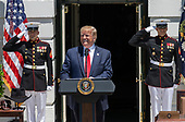 """United States President Donald J. Trump prepares to make remarks as he hosts the Third Annual """"Made in America"""" Product Showcase on the South Lawn of the White House in Washington, DC on Monday, July 15, 2019.<br /> Credit: Ron Sachs / CNP"""