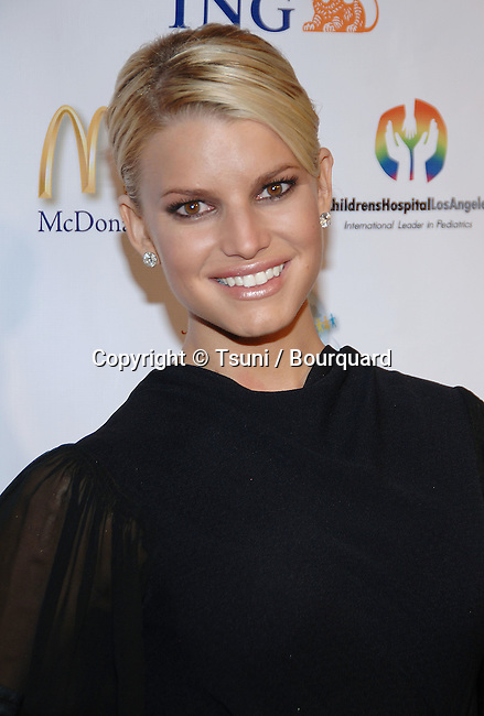 Jessica Simpson arriving at the NOCHE DE NINOS GALA honoring Johnny Depp at the Beverly Hilton In Los Angeles.<br /> <br /> headshot<br /> black dress<br /> smile<br /> eye contact