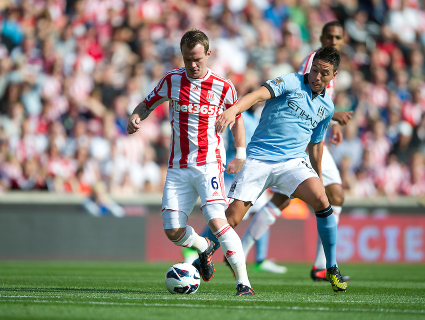 Stoke City's Glenn Whelan and Manchester City's Samir Nasri ..Football - Barclays Premiership - Stoke City v Manchester City - Saturday 15th September 2012 - Britannia Stadium - Stoke..