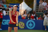 July 8, 2013  (Washington, DC)  Former U.S. Open winner Martina Hingis serves for the Washington Kastles during the teams home opener July 8, 2013.  The Kastles won the game and tied the longest winning streak in U.S. pro sports history with 33 consecutive wins. (Photo by Don Baxter/Media Images International)