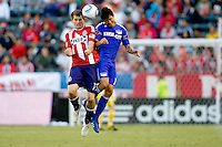 Kansas City Wizards defender Roger Espinoza and Chivas USA forward Justin Braun get it on in the air. The Kansas City Wizards defeated CD Chivas USA 2-0 at Home Depot Center stadium in Carson, California on Sunday September 19, 2010.