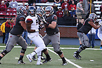 Noah Osur-Myers (55), Washington State offensive lineman, protects his quarterback during the Cougars Pac-12 Conference demolition of the Arizona Wildcats, 69-7, on November 5, 2016, at Martin Stadium in Pullman, Washington.