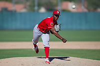 Cincinnati Reds pitcher Cory Thompson (15) follows through on his delivery during an Instructional League game against the Oakland Athletics on September 29, 2017 at Lew Wolff Training Complex in Mesa, Arizona. (Zachary Lucy/Four Seam Images)