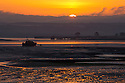 27/05/15<br /> <br /> Seen from the Northam Burrows, the sun rises over the the Mollie Hunt RNLI lifeboat moored in the estuary off Appledore, North Devon.<br /> <br /> All Rights Reserved - F Stop Press.  www.fstoppress.com. Tel: +44 (0)1335 418629 +44(0)7765 242650