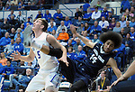 March 1, 2016 - Colorado Springs, Colorado, U.S. -   Air Force guard, Zach Kocur #5, and Aggie forward, Jalen Moore #14, tangle under the basket during an NCAA basketball game between the Utah State University Aggies and the Air Force Academy Falcons at Clune Arena, United States Air Force Academy, Colorado Springs, Colorado.  Utah State defeats Air Force 78-65.