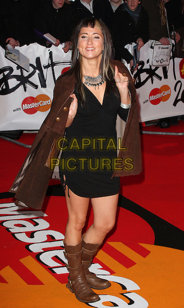 KT TUNSTALL.Arrivals - 2009 Brit Awards, Earls Court, London, England. .February 18th 2009. .brits full length black dress brown boots jacket blunt fringe bangs biker silver necklace suede .CAP/ROS.©Steve Ross/Capital Pictures.