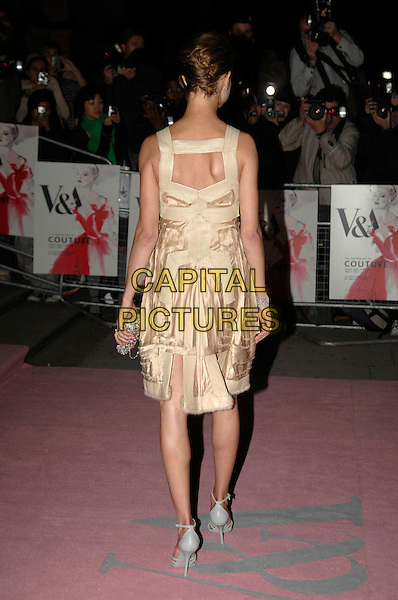 NATALIA VODIANOVA.V&A Golden Age of Couture Gala.Victoria and Albert museum.18th September 2007 London, England.full length gold beige dress back rear view behind.CAP/PL.©Phil Loftus/Capital Pictures