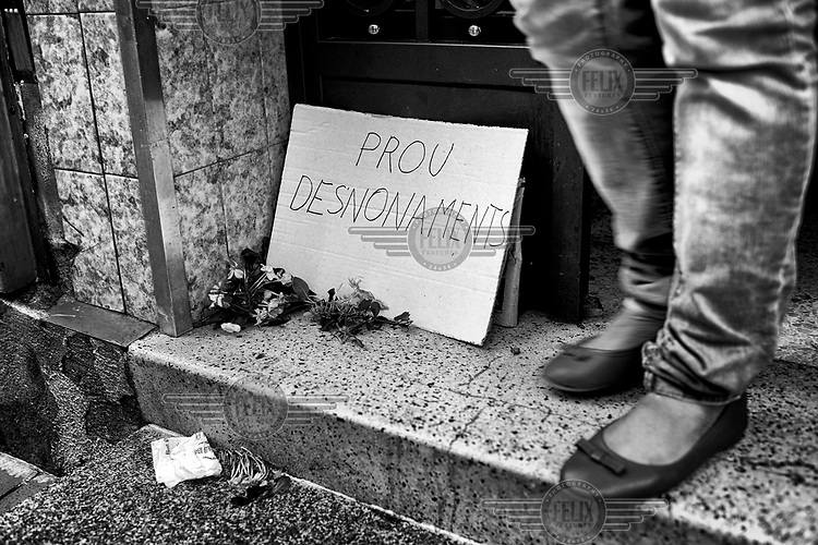 Germania Rivas waits for the arrival of the police and court officals at the entrance of her house. She expected to be evicted but at the last their removal was postponed due to the support of PAH (Mortgage Victims Platform) activists who confronted police, bank and court officials who had come to carry out the eviction.