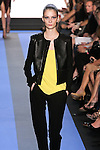 Suzie walks runway in a carbon black leather wool paneled jacket, cadmium yellow crepe racer tank with lace back, and carbon black wool crepe pant with leather racer stripe, by Monique Lhuillier, from the Monique Lhuillier Spring 2012 collection fashion show, during Mercedes-Benz Fashion Week Spring 2012.