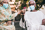Sudanese couple sit and hold a rose while wearing a mask, as a precaution against the spread of the coronavirus disease (COVID-19) in Khartoum, Sudan on May 05, 2020. Photo by faiz Abu bakr