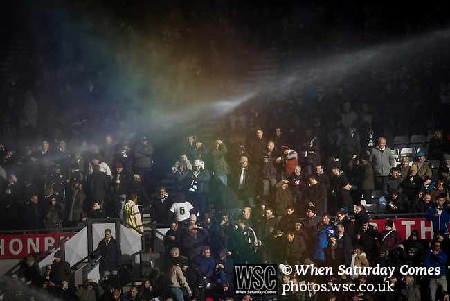 Derby County 1 Nottingham Forest 2, 17/01/2015. iPro Stadium, Championship. Home supporters behind a rainbow caused by the sprinklers at the iPro Stadium before Derby Country's Championship match against Nottingham Forest. The match was won by the visitors by 2 goals to 1, watched by a derby-day crowd of 32,705. The stadium, opened in 1997, was formerly known as Pride Park. Photo by Colin McPherson.
