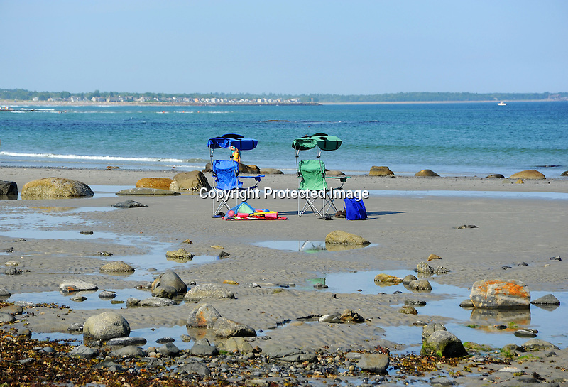 Two Empty Beach Chairs on Shore in Wells, Maine, USA