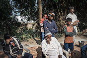 53 year old, Badrinath Singh, (right) father of the rape victim speaks while his younger son, Saurav (in cap) stands behind him during an interview in his ancestral house in Medawar Kalan in Ballia district of Uttar Pradesh, India. Photo: Sanjit Das/Panos for Der Spiegel