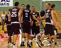 Heat players congratulate Corey Webster on his steal and drive which put the result beyond doubt with less than a minute to go during the NBL match between Manawatu Jets and Harbour Heat at Arena Manawatu, Palmerston North, New Zealand on Saturday 17 April 2010. Photo: Dave Lintott / lintottphoto.co.nz