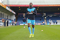 Marcus Bean of Wycombe Wanderers warms up ahead of the Sky Bet League 2 match between Luton Town and Wycombe Wanderers at Kenilworth Road, Luton, England on 26 December 2015 but does not appear in the starting line up or on the substitutes bench. Photo by David Horn.