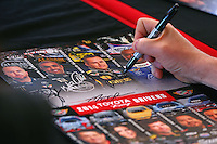 Mar 14, 2014; Gainesville, FL, USA; Detailed view as NHRA top fuel dragster driver Richie Crampton signs autographs during qualifying for the Gatornationals at Gainesville Raceway Mandatory Credit: Mark J. Rebilas-USA TODAY Sports