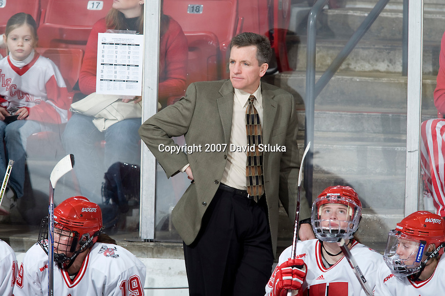 MADISON, WI - DECEMBER 1: Head coach Mark Johnson of the Wisconsin Badgers women's hockey team looks on during the game against the Minnesota Duluth Bulldogs at the Kohl Center on December 1, 2007, in Madison, Wisconsin. The Bulldogs beat the Badgers 3-2. (Photo by David Stluka)