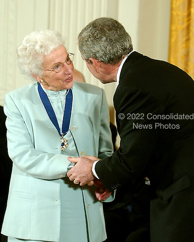 Washington, D.C. - December 15, 2006 -- Ruth Johnson Colvin receives the Presidential Medal of Freedom  from United States President George W. Bush and first lady Laura Bush during a ceremony in the East Room of the White House on Friday, December 15, 2006.  The medal is the nation's highest civil award.  It may be awarded &quot;to any person who has made an especially meritorious contribution to (1) the security or national interests of the United States, or, (2) world peace, or (3) cultural or other significant public or private endeavors&quot;.  Ruth Colvin is a literacy pioneer and one of our Nation&rsquo;s most effective ambassadors to the world on the importance of education.  The founder of Literacy Volunteers of America, she has dedicated her life to helping the less fortunate gain the reading and language skills they need to succeed.  Her work has inspired others to lead lives of service and devote their time and talents to combating illiteracy.  The United States honors Ruth Johnson Colvin for her extraordinary efforts to provide hope and opportunity to people everywhere.<br /> Credit: Ron Sachs / CNP