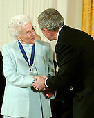 "Washington, D.C. - December 15, 2006 -- Ruth Johnson Colvin receives the Presidential Medal of Freedom  from United States President George W. Bush and first lady Laura Bush during a ceremony in the East Room of the White House on Friday, December 15, 2006.  The medal is the nation's highest civil award.  It may be awarded ""to any person who has made an especially meritorious contribution to (1) the security or national interests of the United States, or, (2) world peace, or (3) cultural or other significant public or private endeavors"".  Ruth Colvin is a literacy pioneer and one of our Nation's most effective ambassadors to the world on the importance of education.  The founder of Literacy Volunteers of America, she has dedicated her life to helping the less fortunate gain the reading and language skills they need to succeed.  Her work has inspired others to lead lives of service and devote their time and talents to combating illiteracy.  The United States honors Ruth Johnson Colvin for her extraordinary efforts to provide hope and opportunity to people everywhere.<br /> Credit: Ron Sachs / CNP"