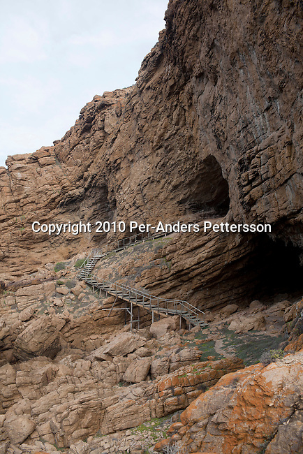 MOSSEL BAY, SOUTH AFRICA - MAY 26: A view of the sea and rocks outside a cave called PP13B on May 26, 2010, at Pinnacle Point near Mossel Bay South Africa. The cave sheltered humans between 164,000 and 35,000 years ago, at a time when Homo sapiens was in danger of dying out. These people may have been the ancestors of us. (Photo by Per-Anders Pettersson/Getty Images)