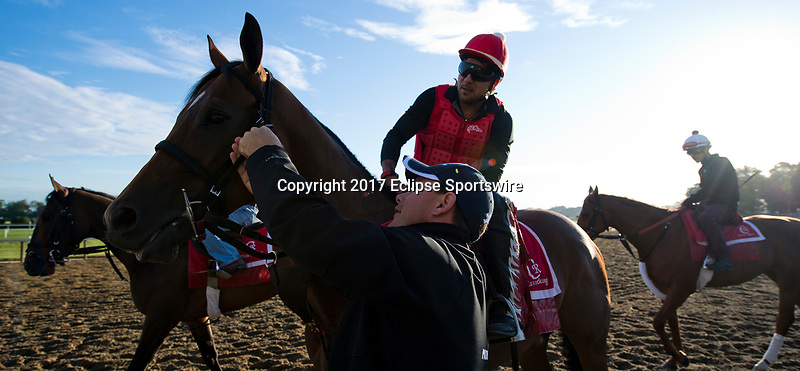 ELMONT, NY - JUNE 09: Assistant Trainer Norm Casse helps fix the tack on on of his horses during morning workouts in preparation for the Belmont Stakes at Belmont Park on June 9, 2017 in Elmont, New York (Photo by Scott Serio/Eclipse Sportswire/Getty Images)