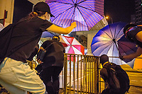 HONG KONG: 07 October 2019 Protesters construct barricades during clashes with riot police in the Mong Kok region of Hong Kong this evening. Violence has continued throughout the city despite the introduction of a new law stating no masks can be warn which, in turn, has escalated the anger of the protesters.   <br /> Rick Findler / Story Picture Agency