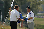 Phil Mickelson and Padraig Harrington shake hands after halving their match on the 18th hole in the opening foursomes at the 37th Ryder Cup at Valhalla Golf Club, Louisville, Kentucky, USA - 19th September 2008 (Photo by Manus O'Reilly/GOLFFILE)