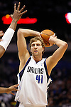 Dallas Mavericks' Dirk Nowitzki looks to pass against the New Orleans Hornets during an NBA basketball game at American Airlines Center in Dallas on February 28, 2010.   (Photo by Khampha Bouaphanh)