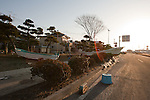Mar. 13, 2011 - Ibaraki, Japan - Boats are shown piled up on the street in Oarai two days after the 8.9 magnitude earthquake struck followed by a tsunami that hit the north-eastern region. The death toll is currently unknown with casualties that may run well into the thousands.