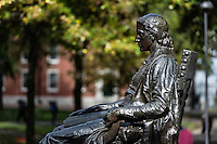 Bronze sculpture of John Harvard overlooking Harvard Yard main campus, Harvard University, Massachusetts, USA