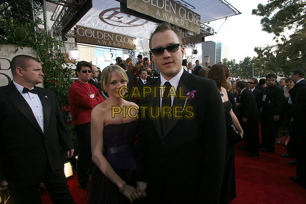 HEATH LEDGER & MICHELLE WILLIAMS.Arrive for the 63rd Golden Globe Awards,.Beverly  Hills Hilton, California, USA,.January 16th 2006..half length globes celebrity couple red carpet sunglasses flower corsage.Ref: AW.www.capitalpictures.com.sales@capitalpictures.com.Supplied By Capital Pictures.