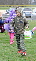 Kody Johannessen, 8, of Feasterville, Pennsylvania searches for easter eggs during a hunt sponsored by the Feasterville Business Association and the Friends of the Lower Southampton Library Saturday March 19, 2016 at Russell Elliot Park in Feasterville, Pennsylvania. (Photo By William Thomas Cain)