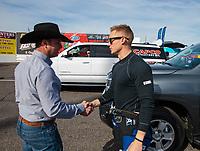 Feb 24, 2019; Chandler, AZ, USA; NHRA top fuel driver Steve Torrence (left) greets Jordan Vandergriff during the Arizona Nationals at Wild Horse Pass Motorsports Park. Mandatory Credit: Mark J. Rebilas-USA TODAY Sports