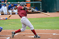 Idaho Falls Chukars second baseman Carlos Garcia #8 follows through on his swing against the Ogden Raptors at Lindquist Field on June 23, 2013 in Ogden, Utah. (Stephen Smith/Four Seam Images)