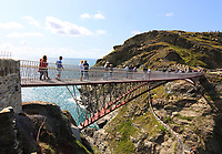 A new footbridge re-connecting the two halves of Tintagel Castle for the first time in 500 years, has at last been opened. <br /> The medieval castle - long rumoured to be the site of King Arthur's legendary Camelot - lost it's original bridge sometime between the 15th and 16th centuries. <br /> A storm which hit the cornish coast this past weekend delayed the bridge's opening until now. Tintagel, Cornwall on August 12 the 2019<br /> <br /> Photo by Keith Mayhew