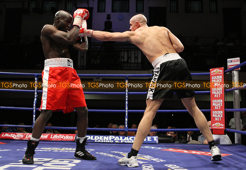 Danny McIntosh (Norwich, black shorts) defeats Nick Okoth (Battersea, red shorts) in a Super-Middleweight contest at York Hall, promoted by Hennessy Sports - 22/02/08 - MANDATORY CREDIT: Gavin Ellis/TGSPHOTO. Self-Billing applies where appropriate. NO UNPAID USE. Tel: 0845 094 6026