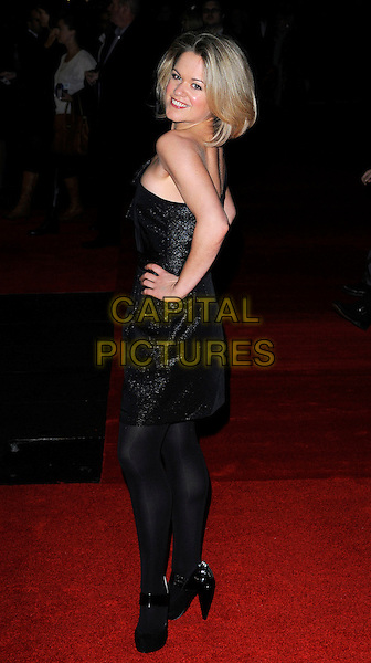 SINEAD KEENAN.attending the European Premiere of 'Harry Brown' at the Odeon Leicester Square, London, England, UK, November 10th 2009. .Full length dress hands on hips back rear behind tights shoes black looking over shoulder one shoulder side .CAP/CAN.©Can Nguyen/Capital Pictures.