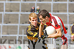 Gavin O'Shea Dr Crokes holds up Rathmore's James O'Sullivan  during their Club Championship semi final on Sunday