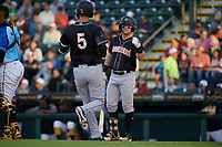 Jupiter Hammerheads Cameron Baranek (8) congratulates Micah Brown (5) after a home run during a Florida State League game against the Bradenton Marauders on April 20, 2019 at LECOM Park in Bradenton, Florida.  Bradenton defeated Jupiter 3-2.  (Mike Janes/Four Seam Images)