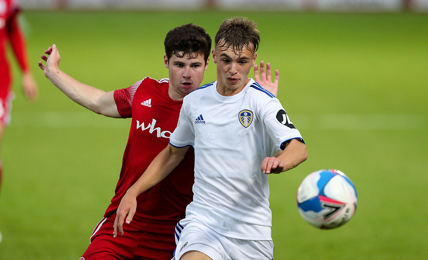 Leeds United U21's Harvey Sutcliffe shields the ball from Accrington Stanley's Ryan Cassidy<br /> <br /> Photographer Alex Dodd/CameraSport<br /> <br /> EFL Trophy Northern Section Group G - Accrington Stanley v Leeds United U21 - Tuesday 8th September 2020 - Crown Ground - Accrington<br />  <br /> World Copyright © 2020 CameraSport. All rights reserved. 43 Linden Ave. Countesthorpe. Leicester. England. LE8 5PG - Tel: +44 (0) 116 277 4147 - admin@camerasport.com - www.camerasport.com